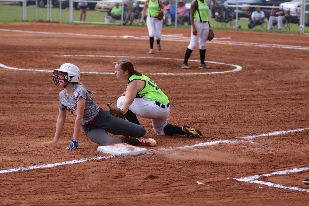 Both players look to the ump for a call in their favor. (Bruce Branum   The Standard)