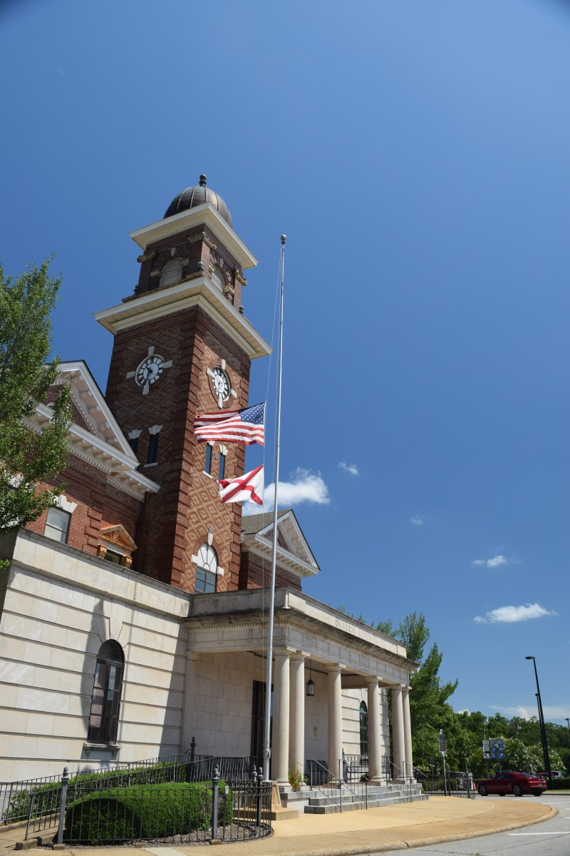 The flags at the courthouse flew at half-staff after the police shootings in Dallas. (Bruce Branum   The Standard)