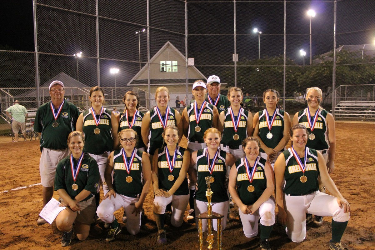 Greenville Dixie Debs team poses with state champion trophy. Pictured are, from left, front row, Coach Hannah Johnson, T.C. Boutwell, Danielle Scott, Knightlyn Mosley, Kristian Ballard, Amber Macks, back row, from left, Coach Matt Langford, Emily Brown, Caitlin Lee, Kaitlyn Padgett, Ashlyn McKeown, Coach Carl Stanford, Olivia Foster, Jodie Lowe and Savannah Mauch. (Photo by Tori J. Norris)