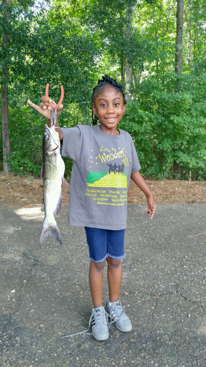 Kinsley McCreary recently caught a nice size catfish, while on an outing with her group from Dunbar Day Camp. Kinsley is 7-years-old and has enjoyed spending her summer weekdays with Deirdre Womack and staff at Dunbar Day Camp. (Michelle Styron | The Standard)