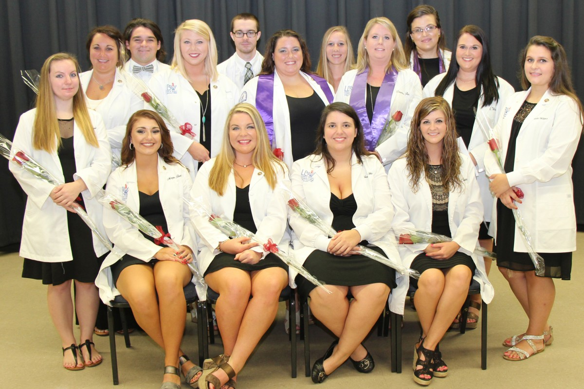 Lurleen B. Wallace Community College recently held a pinning ceremony in Opp for summer graduates of the surgical technology program. Pictured are, seated from left, Morgan Barlow of Andalusia, class vice-president; Katelin Cassady, Andalusia; Jessica Wambles, Opp; Sierra Crews, Samson, class valedictorian; second row (standing), Vicki Springer, Greenville; Brooklyn Little, Andalusia; Derrian Driggers, Opp, class secretary; Amanda Fergus, Dothan, and Deanne Thoma, Enterprise, both members of the National Technical Honor Society (NTHS); Emily Watts and Amanda Skipper, both of Andalusia; third row, Evan Yates of Andalusia, class president; Ben Gordon and Laura Stephens, both of Andalusia; and Jennifer Wilson, Dothan, NTHS member.