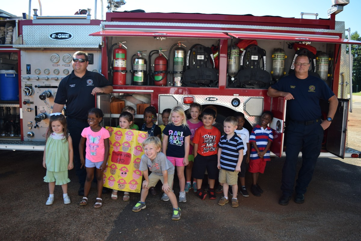 Bright Beginnings students honored Community Helpers on Sept. 16. It was a day where members of the Fire Department, Police Department and Paramedics were appreciated with applause and awe as lights flashed and members of the various departments told their stories to the students. Pictured are students of Jean Hardin's class with GFD Sergeants Barry Alford and Matt Parker. (Bruce Branum | The Standard)