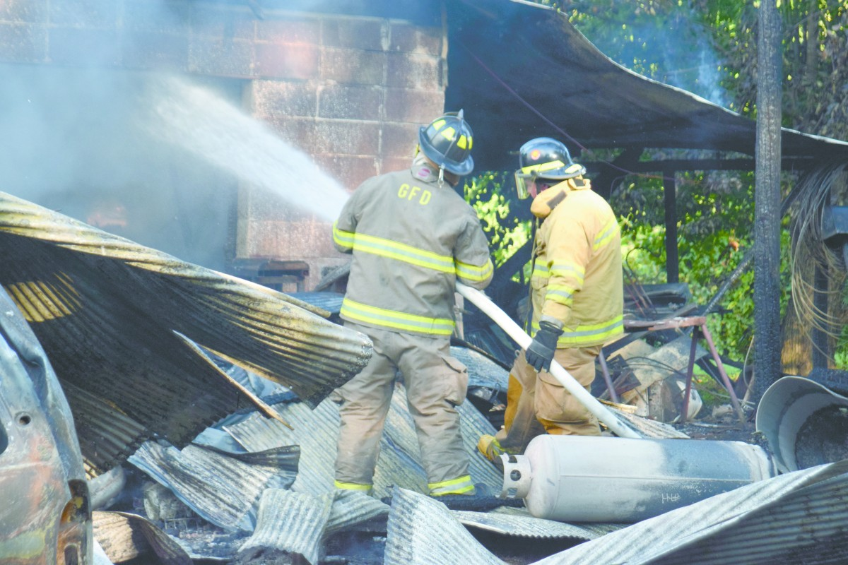 Local fire departments put out building fire by house of Gene Bush. (Bruce Branum/The Standard)