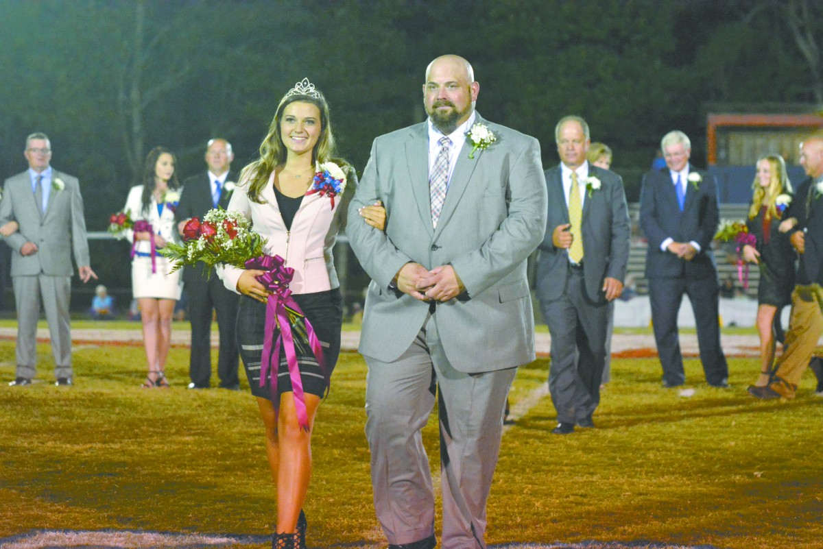FDA Homecoming Queen Madison Langford, escorted by Wayne Butts. (Cecil Folds/The Standard)