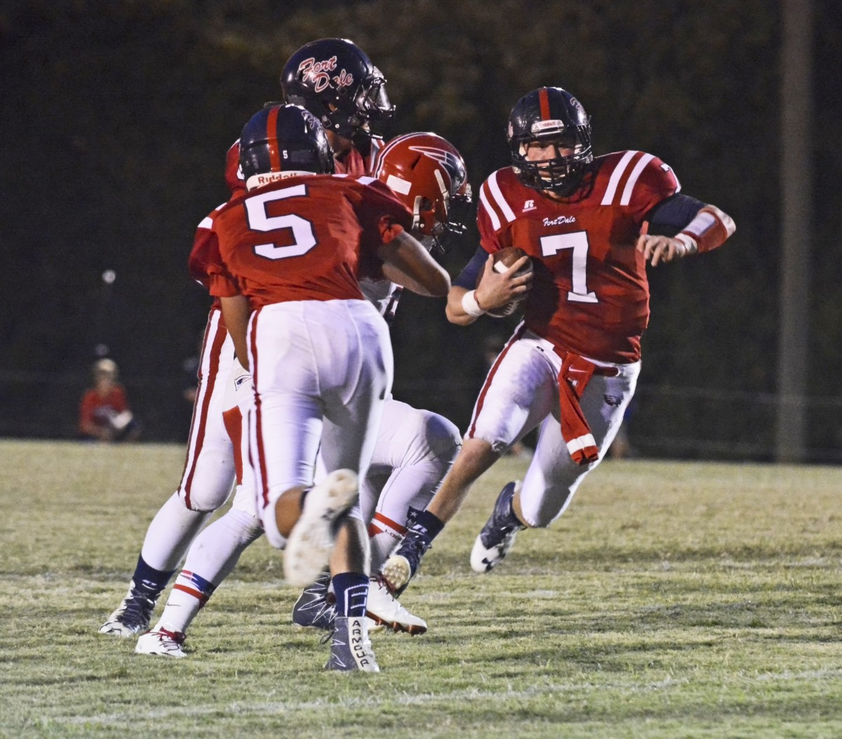 Luke Taylor runs up the middle for big yards with block from TE Trey Coker. (Cecil Folds | The Standard)