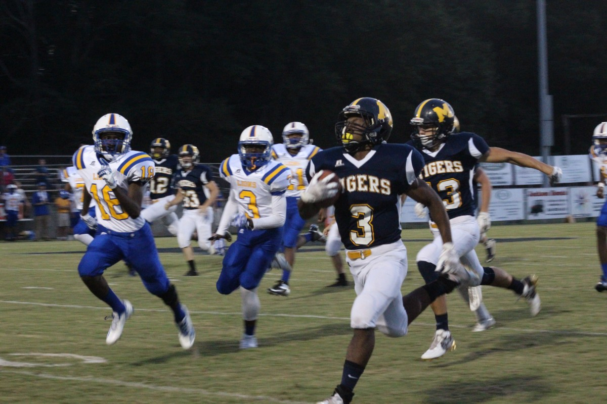 Senior running back Chris Shufford runs the ball in for a touchdown after opening kickoff. Shufford had a total of 399 yards for the night. (Tori J. Norris | The Standard)