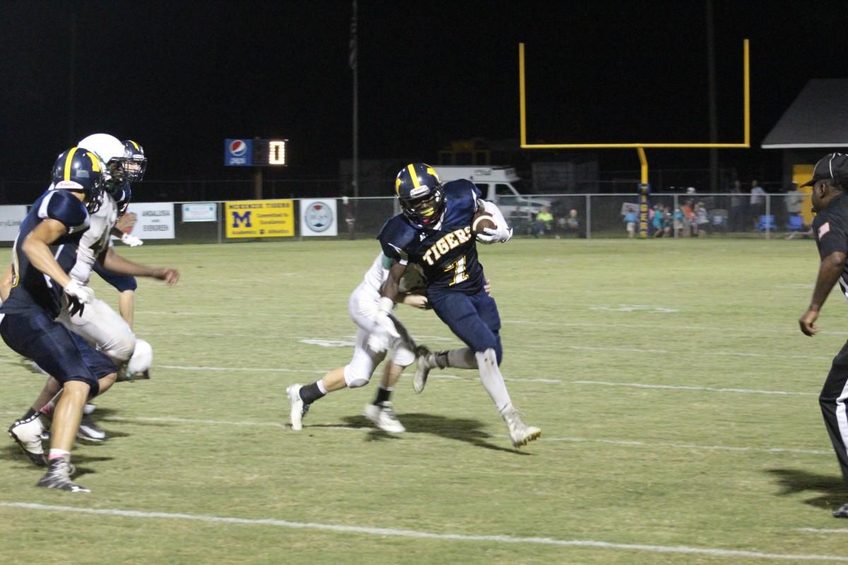 Elijah Vickery avoids a Wildcat defender. (Tori J Norris/The Standard)