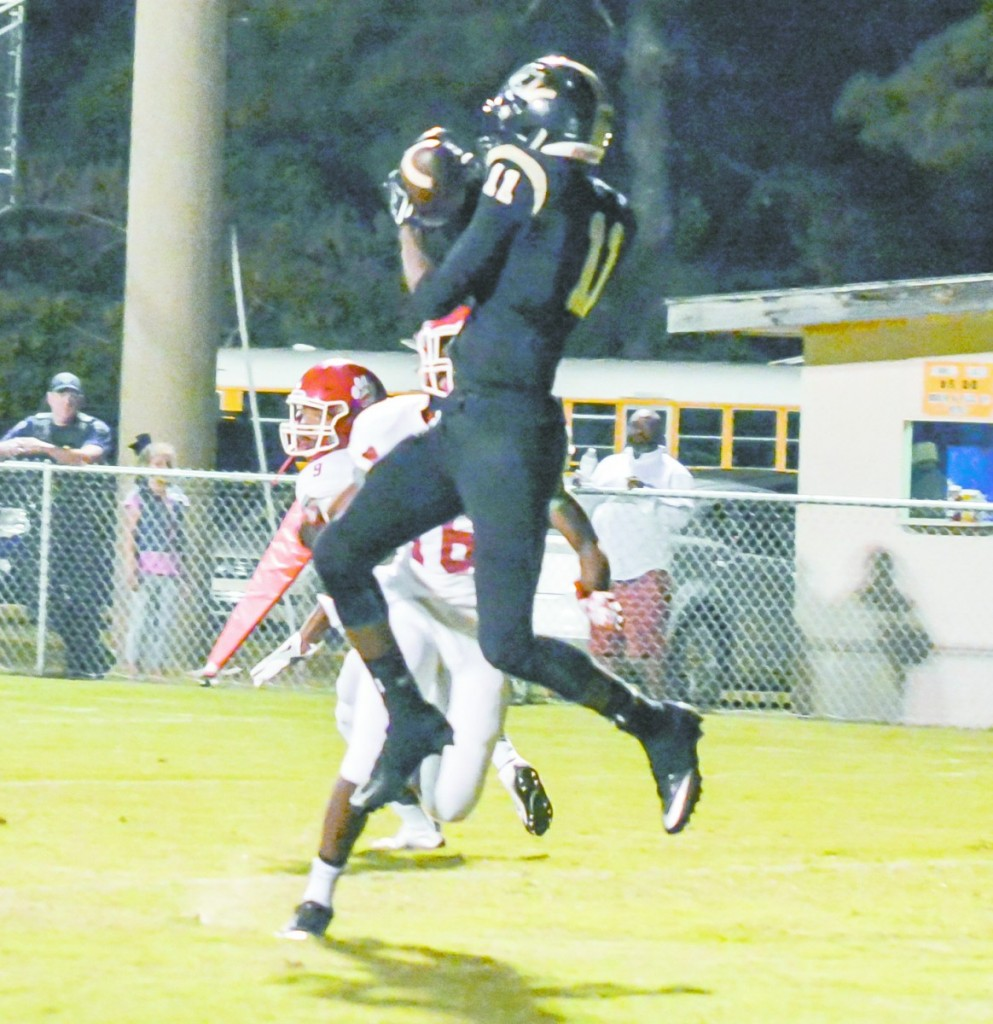 Malik Bunch receives a pass from QB Brandon Simmons for Greenville's only touchdown of the game. (Cecil Folds/The Standard)