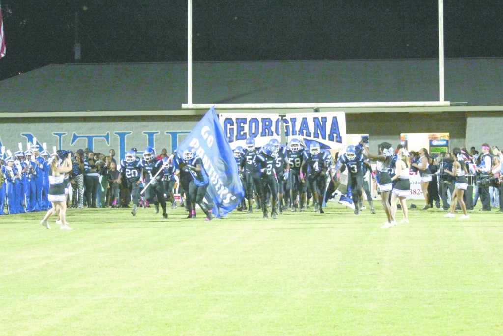 The Panthers take the field in the Battle of 8 Miles last Friday night. (Tori J Norris/The Standard)