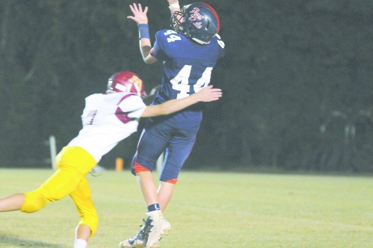 FDA WR #44 Jacob Foster pulls in a pass from QB Baron Brack for big yards and first down. (Photo by Cecil Folds)
