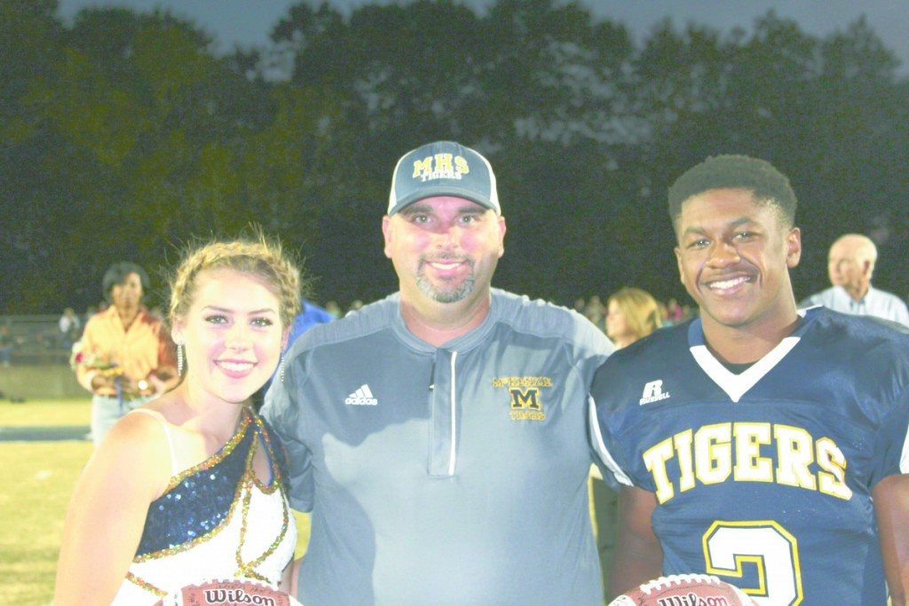 Head Coach Tony Norris stands center of 2016 Mr. and Ms. Football. Each year the players vote on a senior cheerleader or majorette to be Ms. Football and the majorettes and cheerleaders vote on a senior football player to be Mr. Football. Ashley Lynch, head majorette and Chris Shufford were selected this year. They were each presented with a football signed by the football team, cheerleaders and majorettes. (Tori J. Norris/The standard)