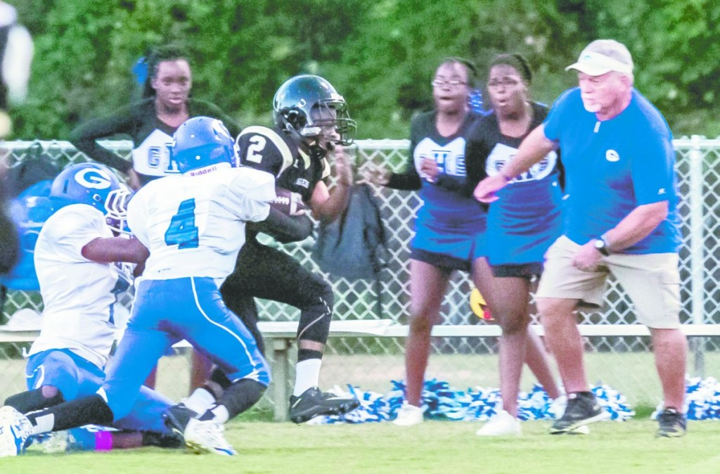 Deangelo Peterson runs down the Georgiana sideline for big yards. (Cecil Folds   The Standard)