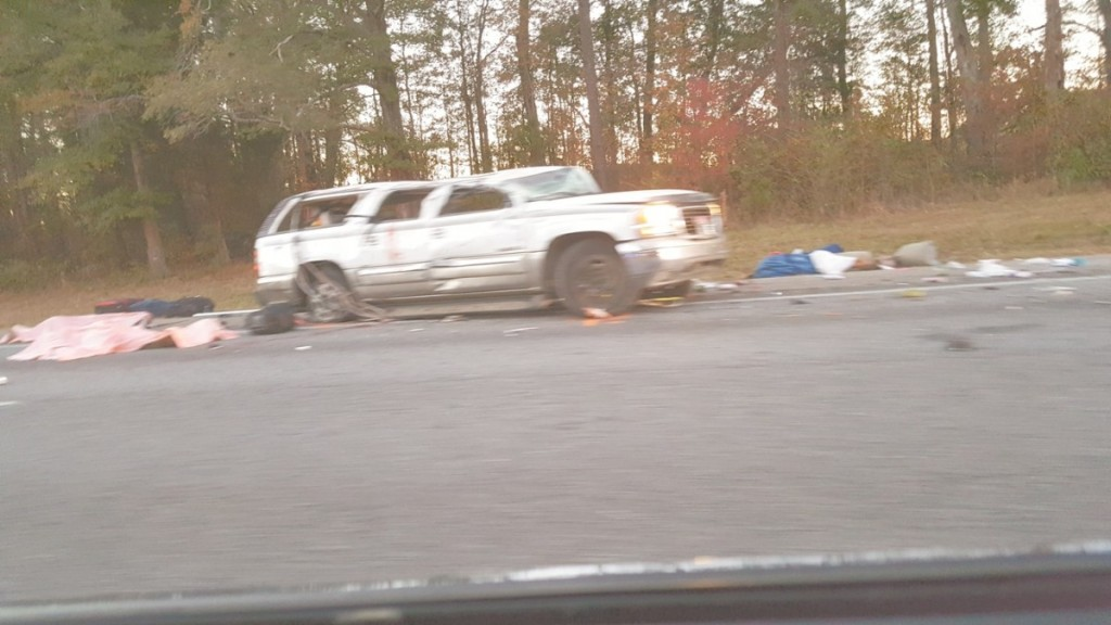 A car wreck, Sunday, Nov. 20, on the south bound lane of I-65 near the 123-mile marker which left two persons dead. Second hand accounts said the vehicle rolled 12 times. Bodies were covered at the scene as authorities performed an investigation and traffic was slowly waved by. (Bruce Branum/The Standard)