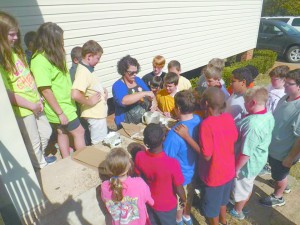 Stacey Edwards demonstrates how to do papier Mache to the fifth grade.(Submitted)