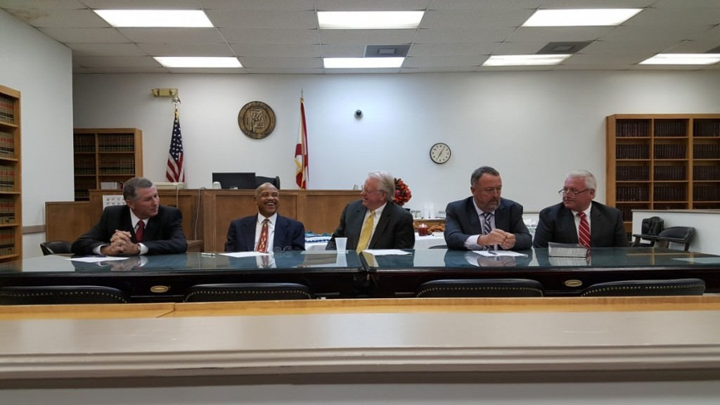 Butler County Commissioners; from left, Darrell Sanders, Allin Whittle, Frank Hickman, Jesse McWilliams and Joey Peavy sit at the signing table. (Bruce Branum/The Standard)