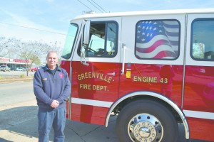 Warrick in front of one of the city's fire engines.(Bruce Branum/The Standard