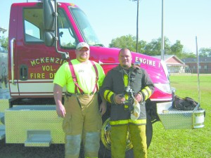 McKenzie VFD firefighters Jay Waters left and Michael Henry, right. (Mollie S. Waters | The Standard)