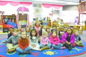 Amy Bryan is pictured with a class of Head Start students. (Bruce Branum/The Standard)