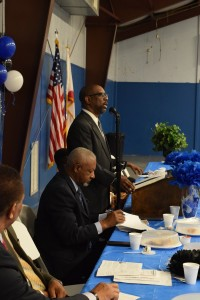 Minister L. Kirk Hatcher speaks at the recent MLK Freedom Breakfast. Also pictured is George Cook, Chairman of the Butler County Civic League. (Bruce Branum/The Standard)