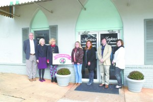 Jane Majors is pictured to the left of the Business of the Month sign, along with members of the Greenville Area Chamber of Commerce (Bruce Branum/The Standard)