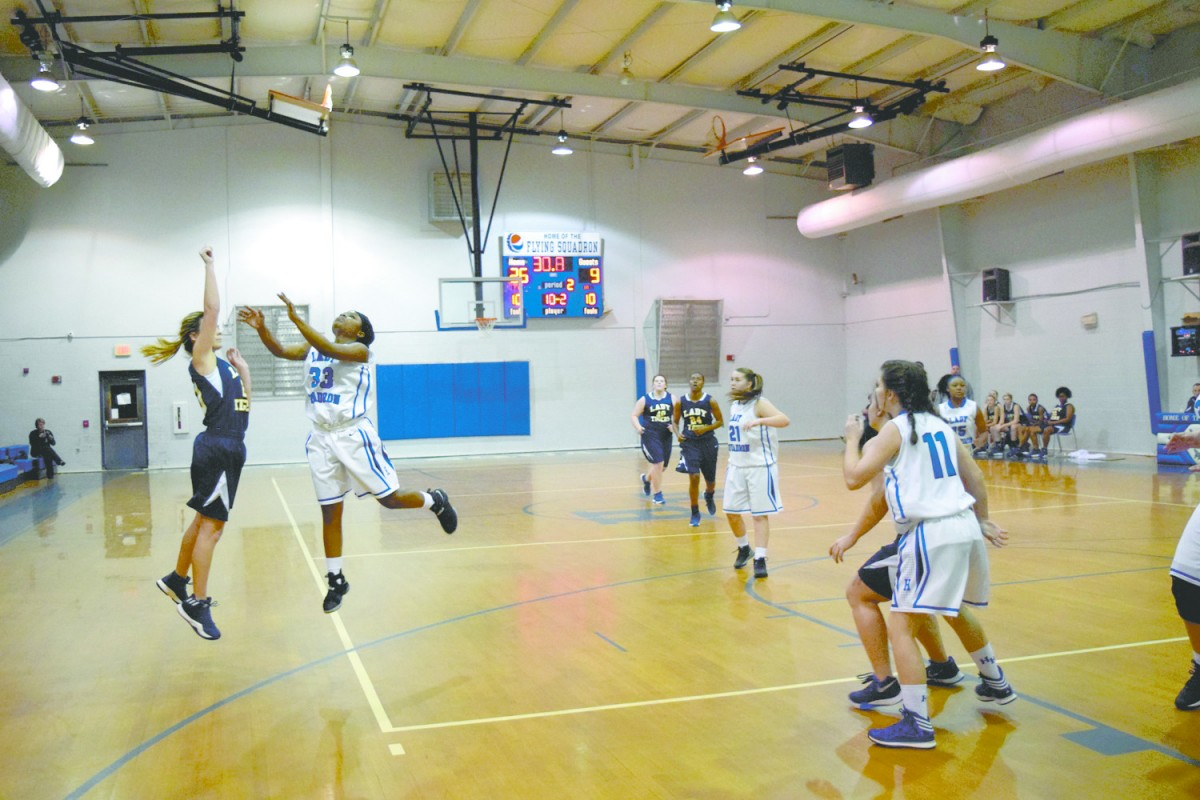 Taylor Turner shoots for three against Highland Home Flying Squadron.(Yalonda Mount/The Standard)