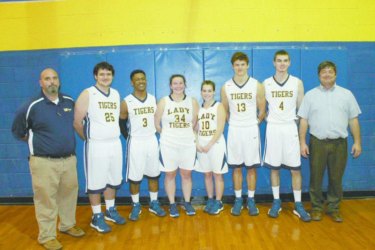 Last Thursday, the McKenzie Tigers played their last regular season games against the Kinston Bulldogs. The Lady Tigers fell 39-35, while the boys won 50-43. Between games, the Tigers recognized their senior basketball players. Pictured left to right; Coach Tony Norris, Tyler Wright, Chris Shufford, Amber Macks, Ashley Lynch, William Brown, Austin Lee and Coach Greg Ennis. (Tori J. Norris | The Standard)