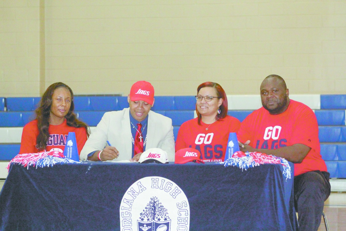 Zeke Powell of Georgiana signed to play football with the University of South Alabama last Wednesday. Pictured left to right: sister, Courtney Powell; Zeke Powell; mother, Candace Powell and father, Ezell Powell. (Tori J. Norris | The Standard)