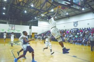 Malik Bunch gets a dunk against Calhoun. (Bruce Branum/The Standard)